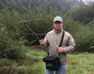 Student with radio transmitting equipment in the field