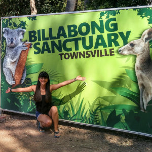 Rachel posing in front of the Billabong Sanctuary in Townsville, AU
